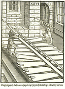 Bellows of a large organ, showing blowers working the bellows. Woodcut from Michael Praetorius 'Syntagma Musicum', 1615-1620.