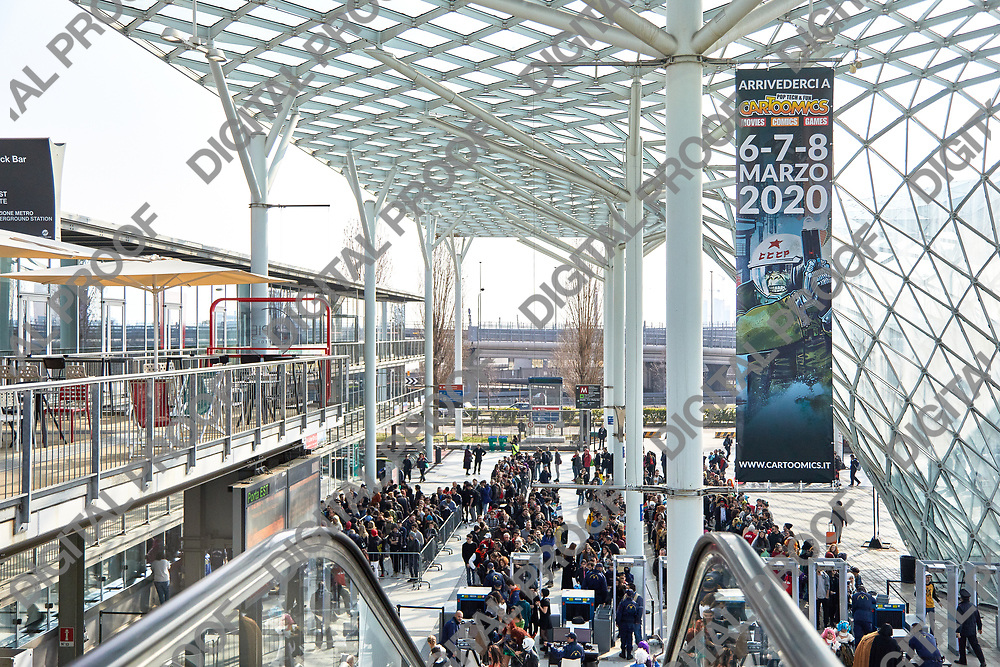 Milan, Italy - March 8 2019 Cartoomics Comic Con Visittors line for passing security check in RHO fiera Milano horizontal