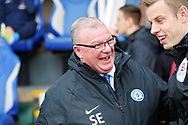 Peterborough United manager Steve Evans jokes with the fourth official before the EFL Sky Bet League 1 match between Peterborough United and Barnsley at The Abax Stadium, Peterborough, England on 6 October 2018.