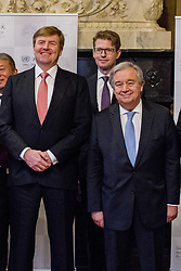 """United Nations Secretary-General Antonio Guterres and Dutch King Willem-Alexander pose for pictures as they attend the International Criminal Tribunal for the Former Yugoslavia (ICTY) closing ceremony after 24 years in the """"Ridderzaal"""", or Hall of Knights, in The Hague, Netherlands on Thursday December 21, 2017. Photo by Robin Utrecht/ABACAPRESS.COM"""
