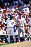 "CHICAGO, IL-SUMMER 1998:   Mark McGwire #25 of the St. Louis Cardinals chats with Sammy Sosa of the Chicago Cubs during a game at Wrigley Field in Chicago, Illinois during the 1998 season.  McGwire and Sosa were part of what has been called the ""Great Home Run Race of 1998"" between the two as they were both attempting to break the single season home run record of 61 held by Roger Maris since 1961.  (Photo by Ron Vesely)"