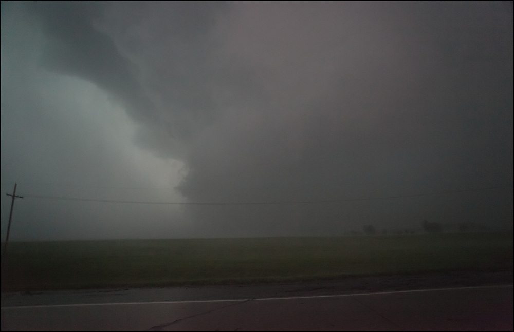 Rain wrapped tornado with extremely high winds with debris and heavy rain east of Marshall, Missouri.