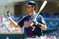 Minnesota Twins DH Joe Mauer calls right fielder Ben Revere home on a wild pitch during a game against the Cleveland Indians at Target Field in Minneapolis, Minnesota on July 29, 2012.  The Twins defeated the Indians 5 to 1.  © 2012 Ben Krause