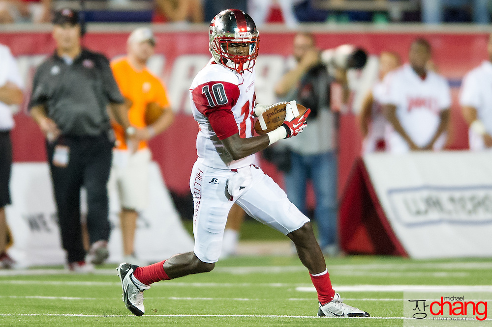 MOBILE, AL - SEPTEMBER 14: Wide receiver Willie McNeal #10 of the Western Kentucky Hilltoppers runs down field during their game agains the South Alabama Jaguars on September 14, 2013 at Ladd-Peebles Stadium in Mobile, Alabama. South Alabama defeated Western Kentucky 31-24.  (Photo by Michael Chang/Getty Images) *** Local Caption *** Willie McNeal