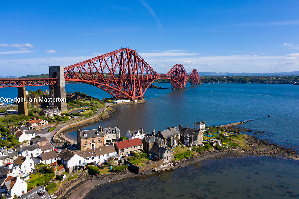 Aerial view of Forth Bridge crossing the River Forth and village of North Queensferry, Fife, Scotland, UK