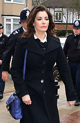 The TV Chef Nigella Lawson arrives at Isleworth Crown Court. London, United Kingdom. Wednesday, 4th December 2013. The TV chef is expected to testify today at trial for Francesca and Elisabetta Grillo, who appear charged with fraud after allegedly using a company credit card to defraud the TV chef and her former husband out of ¬£300,000. Picture by Nils Jorgensen / i-Images<br /> File Photo  - Nigella Lawson and Charles Saatchi PAs cleared of fraud. The trial of Francesca Grillo, 35, and sister Elisabetta, 41, heard they spent £685,000 on credit cards owned by the TV cook and ex-husband Charles Saatchi.<br /> Photo filed Monday 23rd December 2013