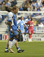 Photo: Aidan Ellis.<br /> Wigan Athletic v Reading. The Barclays Premiership. 26/08/2006.<br /> Wigan's Henri Camara leaves the pitch injured midway through the first half