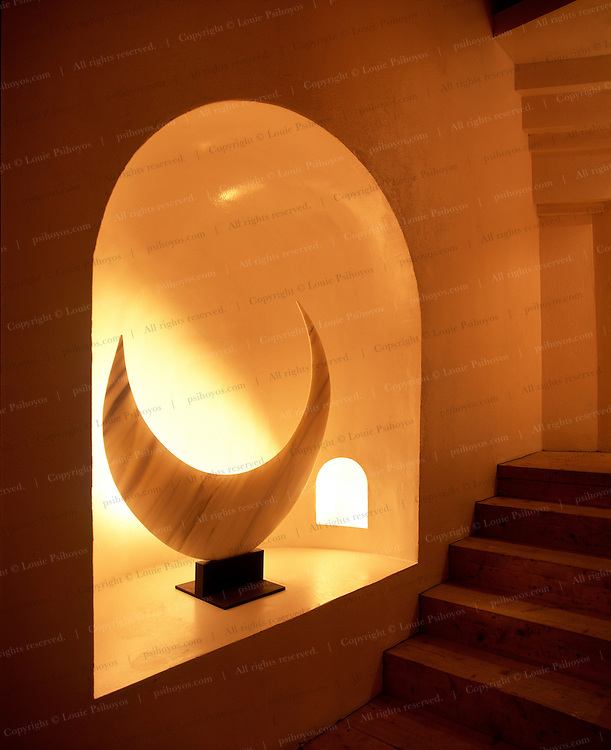 A sliver-thin sculpture in an illuminated alcove at the gallery level of the six story main building.