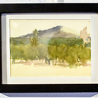 """The water color """"Mt. Taylor"""" by Joan Boyden adorns the wall at the Double Six gallery in Grants Tuesday.  This is the 13th year of the Mount Taylor theme exhibit."""