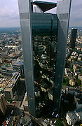 A high-rise office tower that dominates an otherwise flat cityscape in Franfurt's financial district.