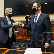 Federal Reserve Chairman Jerome Powell fist bumps Treasury Secretary Steven Mnuchin after a House Financial Services Committee oversight hearing to discuss the Treasury Department's and Federal Reserve's response to the coronavirus pandemic on Wednesday, December 2, 2020.