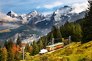 Murren Train with The Eiger 9Left) Monch (middle) & Jungrau (left) - Alps Switzerland .<br /> <br /> Visit our SWITZERLAND  & ALPS PHOTO COLLECTIONS for more  photos  to browse of  download or buy as prints https://funkystock.photoshelter.com/gallery-collection/Pictures-Images-of-Switzerland-Photos-of-Swiss-Alps-Landmark-Sites/C0000DPgRJMSrQ3U