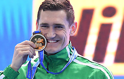 HANGZHOU, Dec. 16, 2018  Cameron van der Burgh of South Africa celebrates during the awarding ceremony of Men's 50m Breaststorke Final at 14th FINA World Swimming Championships (25m) in Hangzhou, east China's Zhejiang Province, on Dec. 16, 2018. Cameron van der Burgh claimed the title with 25.41. (Credit Image: © Xinhua via ZUMA Wire)