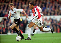 Thierry Henry (Arsenal) Stanislav Varga (Sunderland) Arsenal 2:2 Sunderland. FA Carling Premiership, 30/12/2000. Credit Colorsport / Stuart MacFarlane.