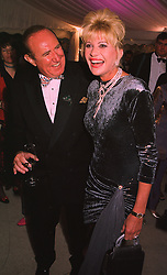 MR ANDREW NEIL and MRS IVANA TRUMP at a reception in London on 6th June 1998.MIB 159
