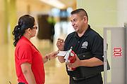 Inspector Miguel Jaimes talks with plant operator Atanacia Tafolla at Ortiz Middle School, September 3, 2015.
