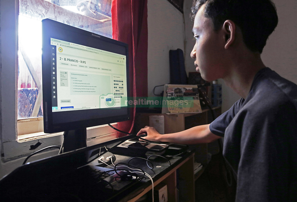 June 4, 2020, Depok, Indonesia: A senior high school student is seen at home working on his computer during the examination class held online due to Covid-19 crisis..The semester examinations for grade 1 and 2 senior high school students is held online from students' homes due to the imposed close of school activities following the coronavirus (COVID-19) pandemic. (Credit Image: © Aslam Iqbal/SOPA Images via ZUMA Wire)