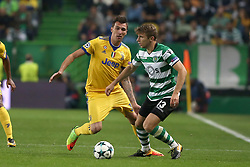 October 31, 2017 - Lisbon, Portugal - Sporting's defender Stefan Ristovsk from Macedonia (R ) fights for the ball with Juventus' Croatian forward Mario Mandzukic during the UEFA Champions League football match Sporting CP vs Juventus at the Alvalade stadium in Lisbon, Portugal on October 31, 2017. (Credit Image: © Pedro Fiuza/NurPhoto via ZUMA Press)