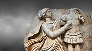 Close up of a Roman Sebasteion relief  sculpture of a Goddess inscribing a trophy, Aphrodisias Museum, Aphrodisias, Turkey.  Against a grey background.<br /> <br /> A draped goddess strides forward to inscribe a military trophy to which is bound a kneeling female captive. The goddess is probably a personification such as Honour, Virtue or Courage. .<br /> <br /> If you prefer to buy from our ALAMY STOCK LIBRARY page at https://www.alamy.com/portfolio/paul-williams-funkystock/greco-roman-sculptures.html . Type -    Aphrodisias     - into LOWER SEARCH WITHIN GALLERY box - Refine search by adding a subject, place, background colour, museum etc.<br /> <br /> Visit our ROMAN WORLD PHOTO COLLECTIONS for more photos to download or buy as wall art prints https://funkystock.photoshelter.com/gallery-collection/The-Romans-Art-Artefacts-Antiquities-Historic-Sites-Pictures-Images/C0000r2uLJJo9_s0