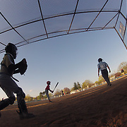 A batter prepares to hit as the catcher collects the ball during the Norwalk Little League baseball competition at Broad River Fields,  Norwalk, Connecticut. USA. Photo Tim Clayton