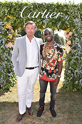 Laurent Feniou and Tinie Tempah at the 'Cartier Style et Luxe' enclosure during the Goodwood Festival of Speed, Goodwood House, West Sussex, England. 15 July 2018.