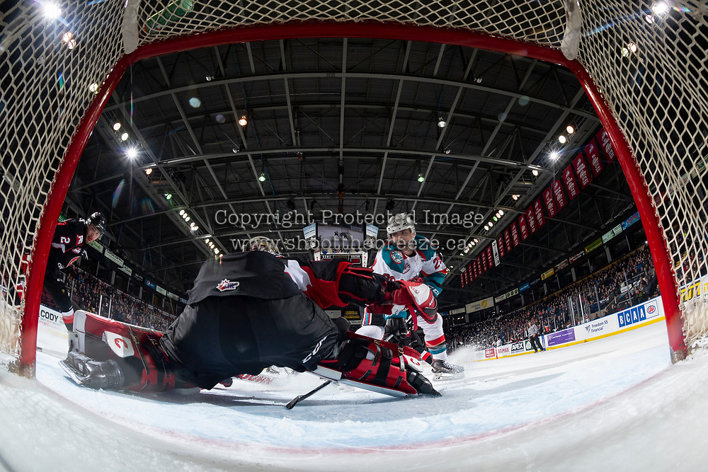 KELOWNA, CANADA - FEBRUARY 8: Taylor Gauthier #35 of the Prince George Cougars makes a save on a shot by Leif Mattson #28 of the Kelowna Rockets on February 8, 2019 at Prospera Place in Kelowna, British Columbia, Canada.  (Photo by Marissa Baecker/Shoot the Breeze)