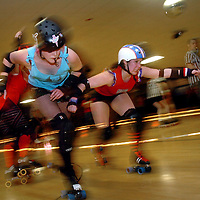 Carolina Rollergirl Princess America, right, edges past a Minnesota Rollergirls player Sunday, Jan. 29, 2006 at the Skate Ranch in Raleigh, N.C. The Carolina Rollergirls won.