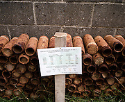 Unearthed and rusting WW1 shells from the Somme battlefield, piled up at Le Tommy Bar, Poziere, France .