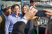 Senator and GOP presidential candidate Marco Rubio speaks poses for a selfie with supporters during a campaign event at the Waters Edge restaurant along Shem Creek in Mount Pleasant, South Carolina. About 100 people turned out to hear the Senator speak in the heart of the shrimping industry along Charleston Harbor.