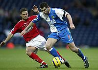 The FA Barclays Premiership<br />3 January 2005, Ewood Park, Blackburn<br />Blackburn Rovers v Charlton Athletic<br />Blackburn Rovers goalscorer Brett Emerton is challenged by Charlton Athletic's Luke Young<br />Pic Jason Cairnduff/Back Page Images