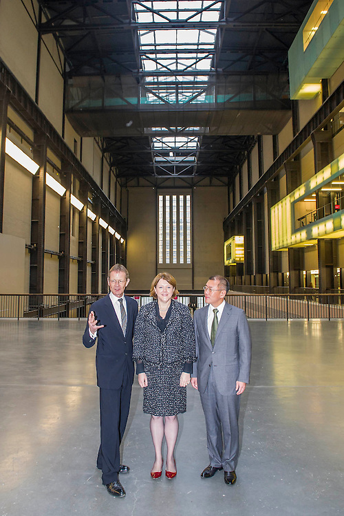 The Rt Hon Maria Miller MP (C), the Secretary of State for Culture, Media and Sport, Euisun Chung (R), vice chairman, Hyundai and Nicholas Serota (L), Director, Tate announce a new 11 year sponsorship deal with Hyundai for the newly reopened Turbine Hall. The announcement coincides with the completion of a new, high level, bridge across the space joining it to the new wing, which will open to the public in 2016. The Tate Modern, London, UK 20 January 2014.