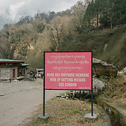 A road signboard warning about safe sex and Aids.