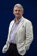 Former Booker prize-nominated British author Simon Mawer, pictured at the Edinburgh International Book Festival where he talked about his latest novel on Word War II. The three-week event is the world's biggest literary festival and is held during the annual Edinburgh Festival. The 2012 event featured talks and presentations by more than 500 authors from around the world.