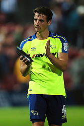 Derby County's Craig Bryson applauds the travelling support