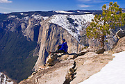 Backcountry skier enjoying the view of El Capitan from Taft Point in winter, Yosemite National Park, California