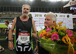 10062018 (Durban) Andre is the last  athletes to pass the finnish line at the Mosses Mabhida stadium venue during the Comrades Marathon on Sunday as Bong'musa Mthembu and Ann Ashworth ensured that the coveted titles remained on these shores.<br /> Picture: Motshwari Mofokeng/African News Agency/ANA