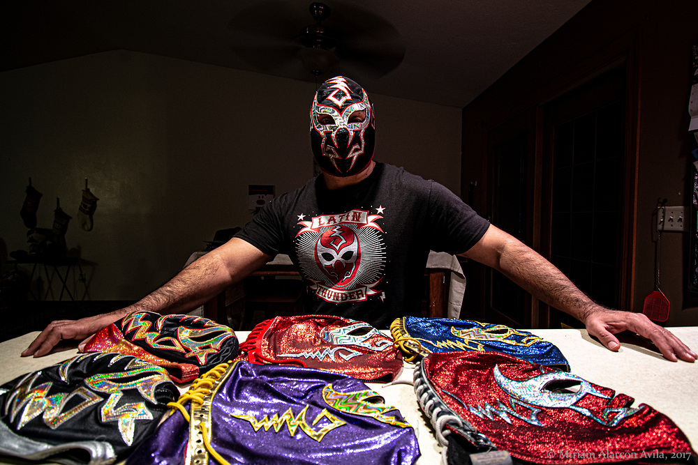 """Luchador Latin Thunder <br />  <br /> I am the Iowa Wrestler, born and raised in Muscatine. I always dreamed of being a professional wrestler. I had my first match at the Sportatorium Arena in Texas, the same ring where """"El Santo"""" and """"Mil Mascaras"""" also fought.<br />  <br /> Lucha Libre was born in Mexico, acrobatic, high-flying, the beautiful colored masks, it is one of the best gifts that Mexico has given the world, such as tequila, mariachi, food, and beautiful music.<br />  <br />  Lucha Libre is the Mexican superheroes! it is the mystery of who is behind the mask; """"rudo"""", """"técnico"""", the good and the bad. I used to be rudo! As I got older I decided to become a good guy, a técnico, luchando with different colored masks.<br />  <br /> The mask keeps your identity a secret, it's a sacrifice to wear it daily!<br />  <br /> My dad is from Piedras Negras, and my mom from Texas, grandmother was born during the war of the Mexican Revolution, her parents left Mexico, she was born on the Texas side, she was a US citizen and she returned to Mexico. Father was an immigrant to the United States in 1966, he was grateful to have a green card to work here.<br />  <br /> When I see hard-working immigrants, I know that all they want is to have a better life. I treat them with dignity and kindness, because they are like my father, only from another generation.<br />  <br /> One of the reasons I became a Luchador is to represent Mexican culture. I am proud of my culture, my roots. Being a Mexican-American is a wonderful part of my life. I love being Latino in Iowa."""