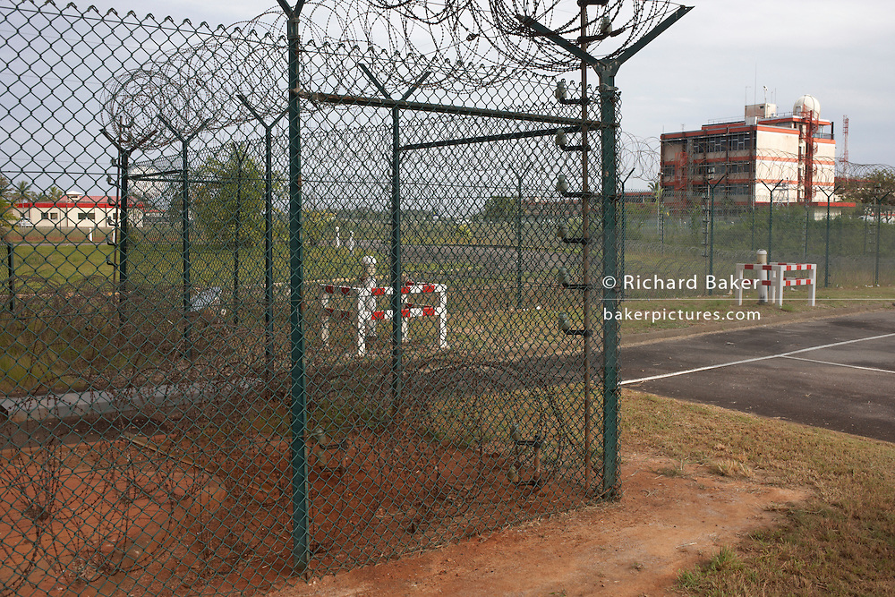 Secure razor wire and fencing keeps tresspassers out from the European Space Agency's Neptune buildings in French Guiana. .