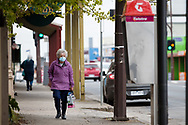 A woman walks along a desolate street  during COVID-19 in Kilmore, Australia. An outbreak which started in Chadstone in Melbourne, has spread as far as Benalla. Twenty-eight people linked to the outbreak have now tested positive for COVID-19. There are now two confirmed cases in Kilmore linked with a Melbourne Resident who carried the virus into the town. The person visited the Odd Fellows Cafe in Kilmore which lead to him spreading the virus to a staff member, and a customer. The cafe has been closed for deep cleaning and will remain closed until the 19th October. (Photo by Dave Hewison/Speed Media)