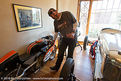 "Robert Gustavsson or ""Big Swede"" as he is fondly known, checking out Jeff Decker's collection during a hosted visit to Jeff's studio on Stage 11 (289 miles) of the Motorcycle Cannonball Cross-Country Endurance Run, which on this day ran from Grand Junction, CO to Springville, UT., USA. Tuesday, September 16, 2014.  Photography ©2014 Michael Lichter."