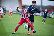 Stevenage defender Luther James-Wildin (2) and Morecambe forward Cole Stockton (9) battle for the ball during the EFL Sky Bet League 2 match between Stevenage and Morecambe at the Lamex Stadium, Stevenage, England on 6 February 2021.