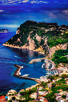 """""""Panoramic view of the majestic Island of Capri""""...<br /> <br /> On the third morning in Sorrento, I departed on a high speed Ferry to the island of Capri.  Although promoting high-speed, it still took over an hour to arrive at the very crowded Island.  Capri is located off the coast of Naples and there must be a new Ferry full of tourists arriving every 20 minutes throughout the day.  Famous for its Blue Grotto, which I did not venture to this trip, Capri is a picturesque Mediterranean retreat with high cliffs and ancient Roman villas. The highlight of my visit was the small and very crowded bus ride along the cliffs edge to Anacapri.  I was standing closest to the door on the right side of the bus during the assent up the mountainside.  All I could see was the rocky shore below and with every leaning left turn, prayed desperately I would make it to the top.  Anacapri is a historic mountaintop town with commanding views of Capri and the sea below."""