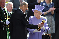 22/06/2012. Queen Elizabeth II receives a trophy from the Duke of Edinburgh after her horse Estimate won the Queen's Vase during day four of the 2012 Royal Ascot meeting at Ascot Racecourse, Berkshire. The Royal couple will celebrate their platinum wedding anniversary on November 20.
