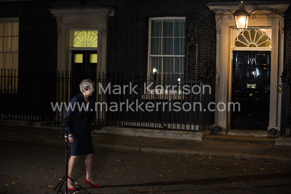 London, UK. 14th November, 2018. Prime Minister Theresa May returns to 10 Downing Street after making a statement to the media following approval of a draft Brexit agreement at a five-hour emergency Cabinet meeting.