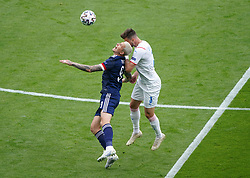 Scotland's Lyndon Dykes and Czech Republic's Ondrej Celustka (right) battle for the ball in the aire during the UEFA Euro 2020 Group D match at Hampden Park, Glasgow. Picture date: Monday June 14, 2021.