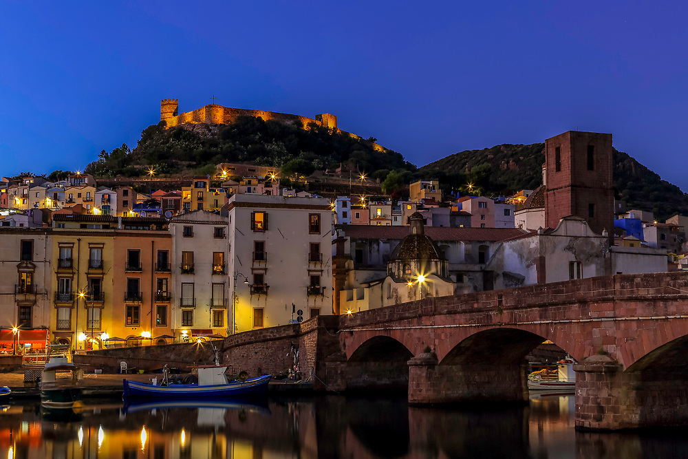 The multi-coloured houses of Bosa at blue hour, Sardinia, Italy.