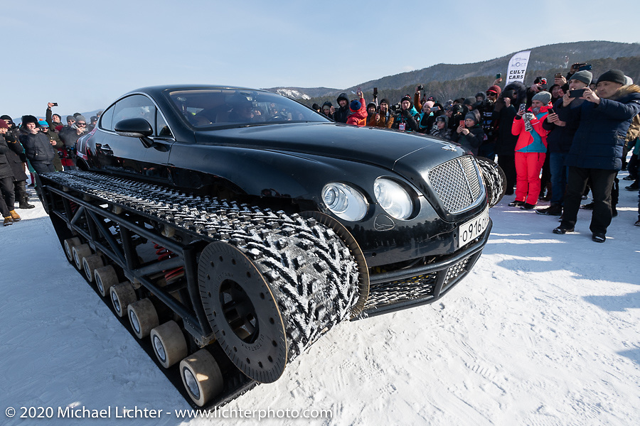 Academeg (Konstantin Zarucki), a YouTuber with 4.3 million subscribers gets surrounded by fans as he drives his Bentley Continental Ultratank, a Continental (new Continentals start at $202,000!) that he modified with winter tracks for the Baikal Mile Ice Speed Festival. Maksimiha, Siberia, Russia. Saturday, February 29, 2020. Photography ©2020 Michael Lichter.