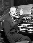 10/12/1952<br /> 12/10/1952<br /> 10 December 1952<br /> Norman Metcalfe at the Compton organ in the Theatre Royal, Dublin. Mr. Metcalfe was a well known organist who also worked in television.
