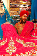 The Chandan Saree shop in the Geerrard India Bazaar, otherwise known as Little India.  Pictured here is owner Kuki Shah Singh, owner and designer of the Chandan Saree Shop, showing off some of his latest designs.