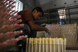 November 1, 2018 - Dhaka, Bangladesh - A child works at balloon factory in Keranigange as he work from 8 am until 5 pm earn 10$ per week. More than 1.2 million children under the age 14 are working in this type's small factory, according to latest National Child Lanour report on child labour. (Credit Image: © MD Mehedi Hasan/ZUMA Wire)